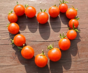 Natural sign of love - heart made from small tomatoes